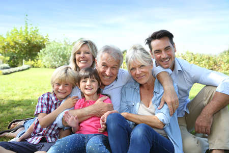 Foto de Happy 3 generation family in grandparents' backyard - Imagen libre de derechos