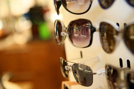Closeup of sunglasses set on display unit in optical store