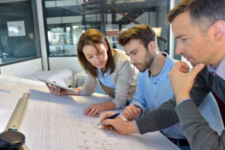 Photo pour Team of architects working on construction project - image libre de droit