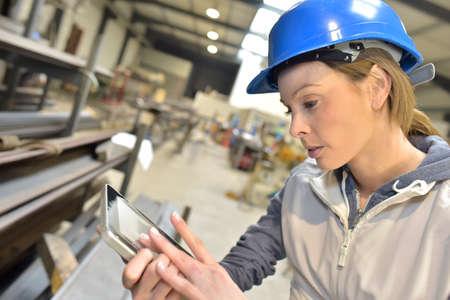 Photo pour Woman engineer in steel plant checking production - image libre de droit