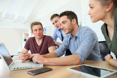Photo for Group of young people in business training - Royalty Free Image