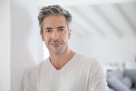 Foto de Portrait of attractive 50-year-old man - Imagen libre de derechos