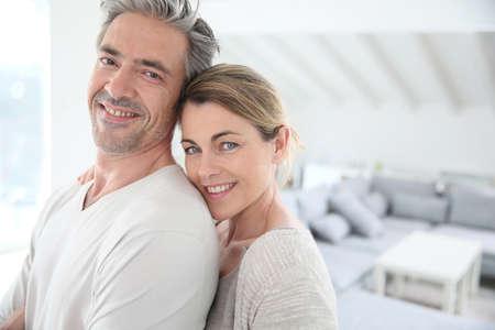 Photo pour Happy mature couple in brand new home - image libre de droit