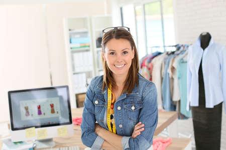Foto de Portrait of smiling fashion designer in studio - Imagen libre de derechos