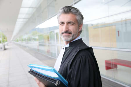 Foto de Portrait of lawyer standing outside courthouse building - Imagen libre de derechos