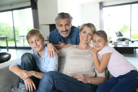Foto de Happy family in contemporary house - Imagen libre de derechos