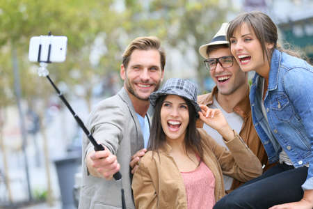 Photo for Group of friends taking picture of themselves with smartphone - Royalty Free Image