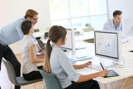 Foto de Creative people working in office on computer - Imagen libre de derechos