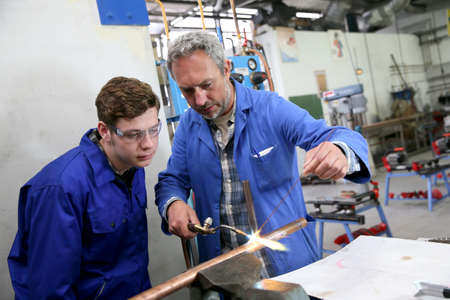 Photo for Teacher with student in metallurgy workshop - Royalty Free Image