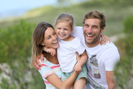 Foto de Portrait of happy family having fun together - Imagen libre de derechos