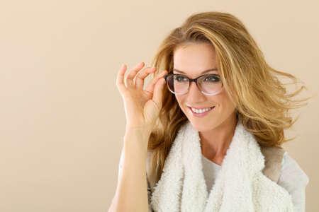 Photo pour Attrative trendy mature woman with eyeglasses, isolated - image libre de droit