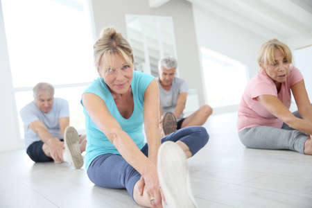 Photo for Group of senior people doing stretching exercises - Royalty Free Image