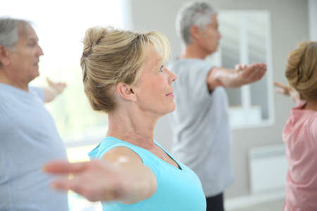 Foto de Senior people stretching out in fitness room - Imagen libre de derechos