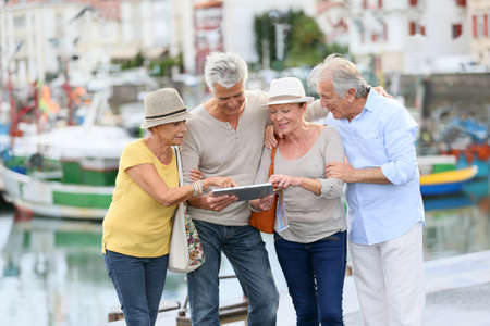 Foto de Senior couples looking at map on traveling journey - Imagen libre de derechos