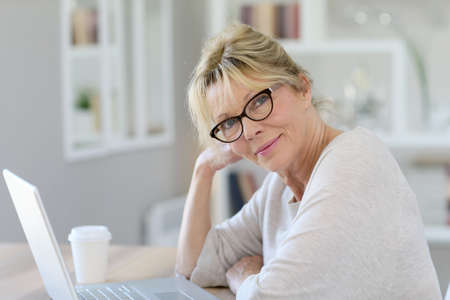 Photo for Portrait of senior woman working on laptop computer - Royalty Free Image