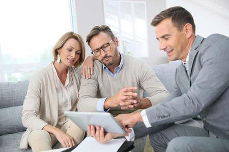 Photo pour Financial adviser showing terms of contract on tablet - image libre de droit