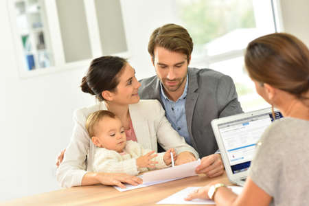 Photo for Family meeting real-estate agent for house investment - Royalty Free Image