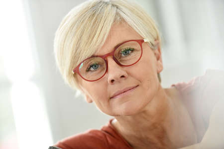 Foto per Portrait of smiling senior woman with eyeglasses - Immagine Royalty Free