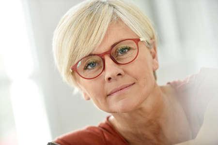 Foto für Portrait of smiling senior woman with eyeglasses - Lizenzfreies Bild