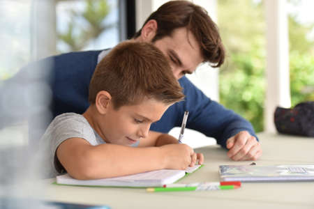 Photo for Man helping son with homework - Royalty Free Image
