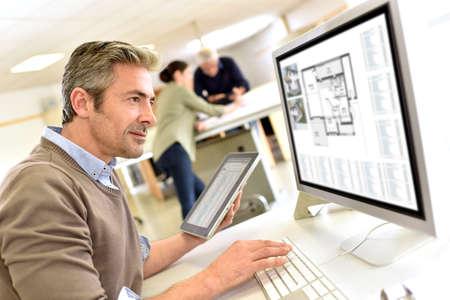 Photo pour Engineer working in design office on desktop computer - image libre de droit