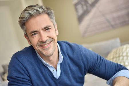 Photo pour Portrait of smiling handsome man with grey hair - image libre de droit