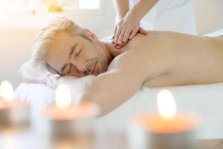Photo pour Man relaxing on massage table receiving massage - image libre de droit