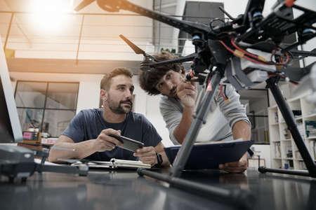 Foto de Engineer and technician working together on drone in office - Imagen libre de derechos