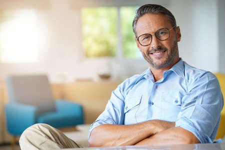 Photo pour Portrait of handsome 45-year-old man with eyeglasses - image libre de droit