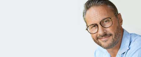 Photo pour Portrait of mature man with eyeglasses and blue shirt, template - image libre de droit