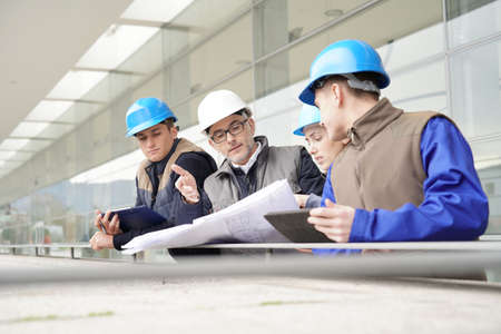 Photo for Construction manager giving instructions to training students - Royalty Free Image
