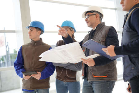 Photo for Instructor with young people in engineering training - Royalty Free Image