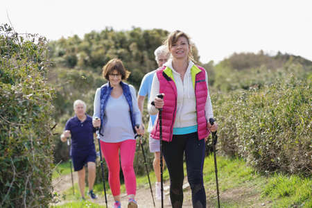 Photo for Senior people nordic walking by the atlantic coast - Royalty Free Image