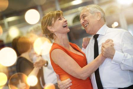 Photo pour Romantic senior couple dancing together at dance hall - image libre de droit