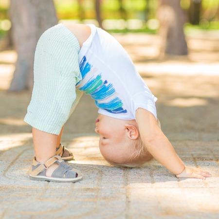 Photo for Baby doing yoga exercises - Royalty Free Image