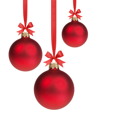 Photo pour three red christmas balls hanging on ribbon with bows, isolated on white - image libre de droit