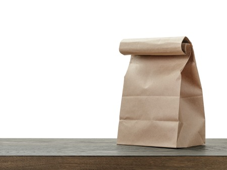 Photo for simple brown paper bag for lunch or food on wooden table - Royalty Free Image