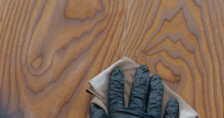 Photo for Closeup man applying protective oil finish to ash floor - Royalty Free Image