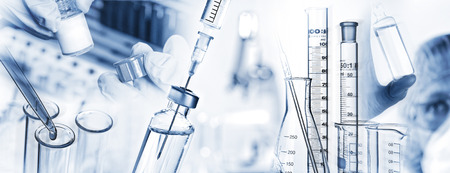 Foto de Analysis system, syringe, microscope and other laboratory utensils. - Imagen libre de derechos