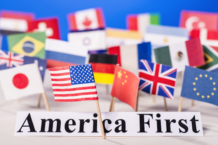 Photo pour American flag is in front of the slogan America First and many flags of other countries. - image libre de droit