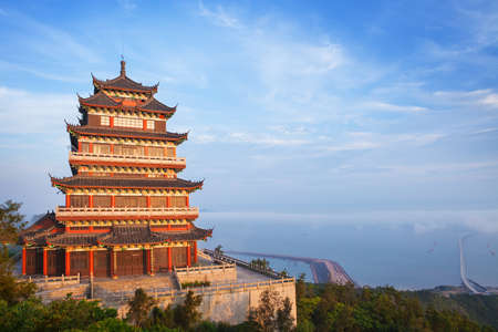 Photo for Beautiful ancient temple on the seaside with blue sky and fog, Dongtou island, Wenzhou, Zhejiang province, China - Royalty Free Image