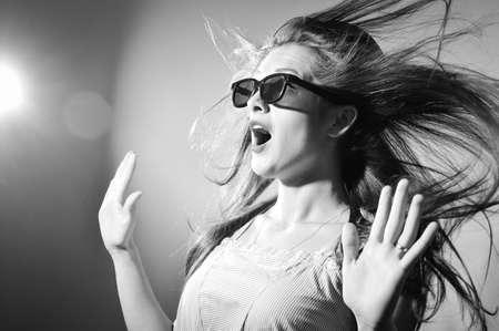 Foto de Portrait of surprised young beautiful lady in 3d glasses looking amazed. Black and white photography - Imagen libre de derechos