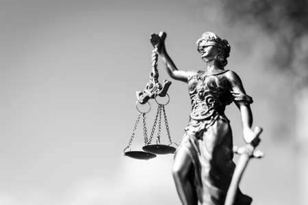 Photo pour Black and white photography of sculpture of themis, femida or justice goddess on bright sky copy space background - image libre de droit