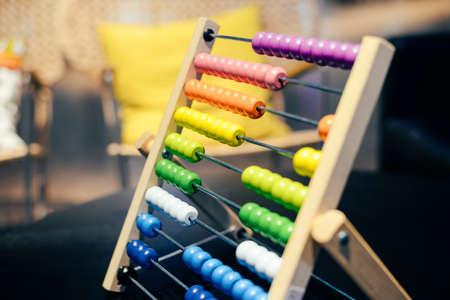 Foto de Educational colorful wooden abacus beads on table background. School arithmetic symbol, calculating thinking concept, closeup photography - Imagen libre de derechos