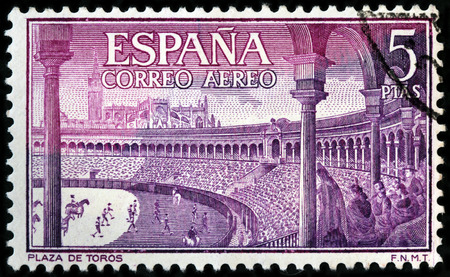 Foto de LUGA, RUSSIA - APRIL 26, 2017: A stamp printed by SPAIN shows beautiful view of Bullring - an arena where bullfighting is performed, circa 1960 - Imagen libre de derechos