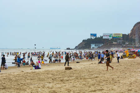 Foto de Vung Tau, Vietnam - January 29, 2018: Local residents and tourists on the waterfront and on the beach - Imagen libre de derechos