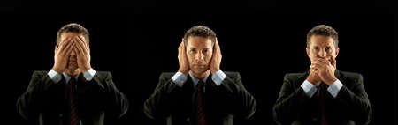 Photo pour Businessman covering his mouth, eyes and ears on black background - image libre de droit