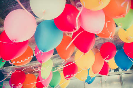 Colorful balloons floating on the ceiling of a party in vhildhood memory