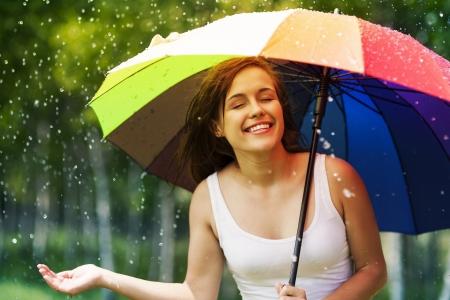 Foto de Beautiful woman enjoying summer rain  - Imagen libre de derechos