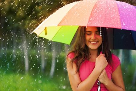 Foto de Beautiful woman under rainbow umbrella - Imagen libre de derechos